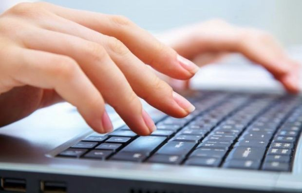 typing-on-laptop-750x482